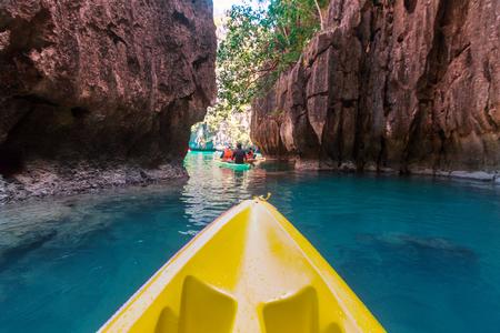 Kayak in the island lagoon between mountains. Kayaking journey in El Nido, Palawan, Philippines. Stock Photo