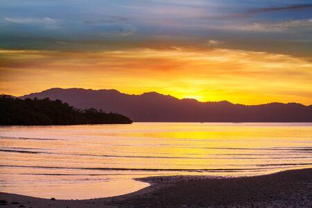 Serenity tropical sunset on beautiful sandy beach