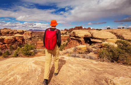 Hike in the Utah mountains. Hiking in unusual natural landscapes. Fantastic forms sandstone formations. Фото со стока
