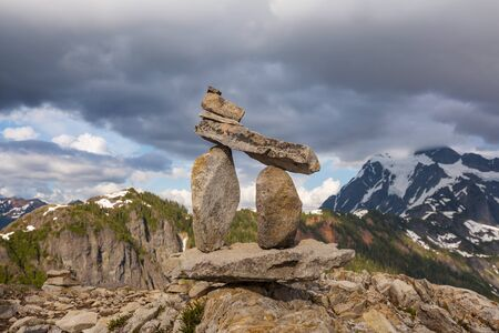 Stack of rocks called a cairn in high mountains