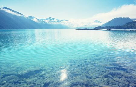 Hike to turquoise waters of picturesque Garibaldi Lake near Whistler, BC, Canada.
