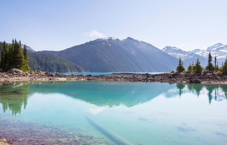 Hike to turquoise waters of picturesque Garibaldi Lake near Whistler, BC, Canada. 스톡 콘텐츠 - 128895588