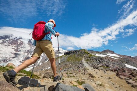 Backpacker in hike in the autumn mountains Banco de Imagens