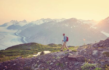 Hiking man in Canadian mountains. Hike is the popular recreation activity in North America. There are a lot of picturesque trails. Stock fotó