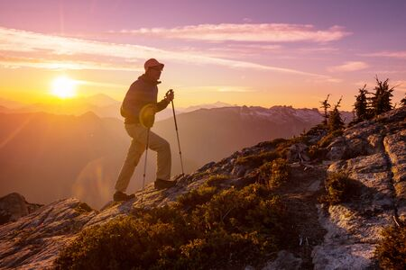 Hiking scene in beautiful summer mountains at sunset Banque d'images