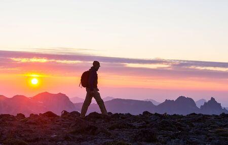 Hiking scene in beautiful summer mountains at sunset Фото со стока
