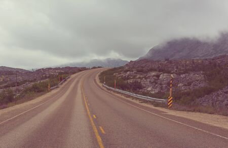 Scenic road in the mountains. Travel background.