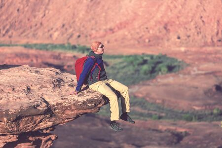 Man on the mountains cliff. Hiking scene. 스톡 콘텐츠