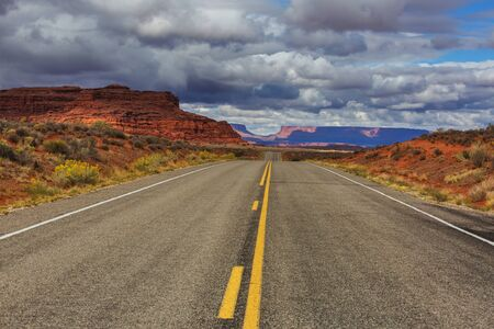 Road in the prairie country. Deserted natural travel background.