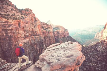 Hike in Zion National Park. Man walk on the trail  in Zion National park,Utah. Back turned no face visible. 스톡 콘텐츠