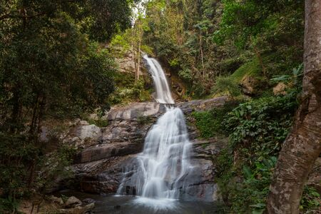 Waterfall in the beautiful green forest