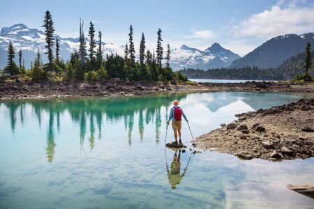 Hike to turquoise waters of picturesque Garibaldi Lake near Whistler, BC, Canada Stock Photo
