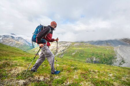 Hiking man in Canadian mountains. Hike is the popular recreation activity in North America. There are a lot of picturesque trails. 版權商用圖片