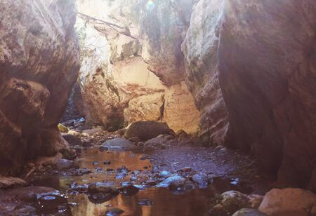 Tourist in Avakas Gorge. Paphos District, Cyprus. Famous small canyon in Sounh Cyprus.