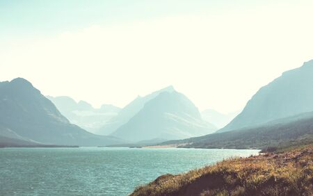 Picturesque rocky peaks of the Glacier National Park, Montana, USA. Beautiful natural landscapes.