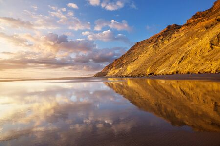Beautiful Sunset at the Ocean Beach, New Zealand. Inspiring natural and travel background