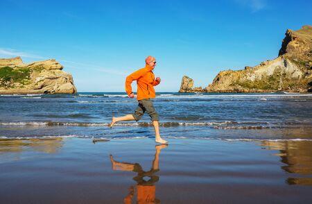 Running man in ocean coast