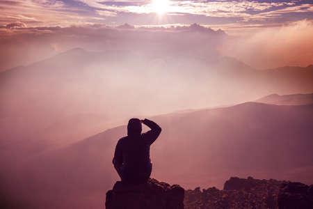 silhouette of man seating on the mountain, inspiration concept scene Reklamní fotografie