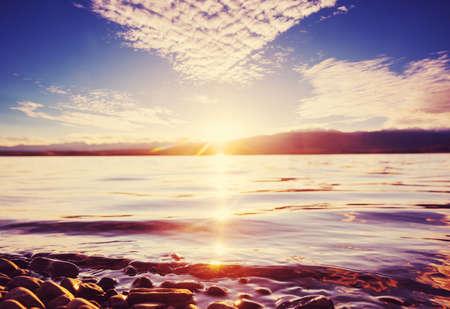 Sunset scene on the lake at sunset autumn nature landscapes Standard-Bild