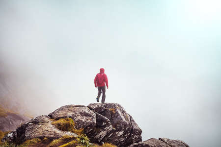 Backpacker in hike in the high mountains Banque d'images
