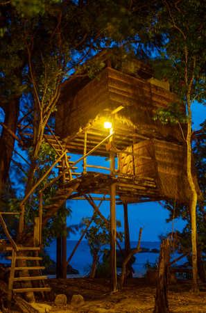 Tropical bamboo hut on sea shore