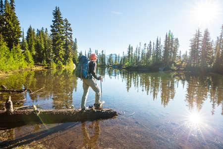 Man relaxing at beautiful mountains lake.