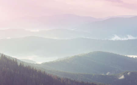 Mountains silhouette at sunrise. Beautiful natural background.