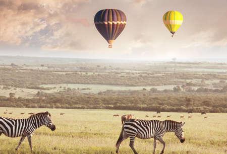 Tourist attraction on african safari in Namibia -balloons over savannah