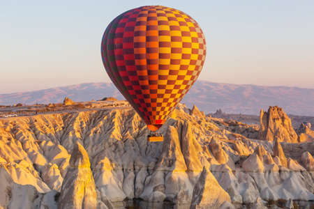 Colorful hot air balloons in Goreme national park, Cappadocia, Turkey. Famous touristic attraction.