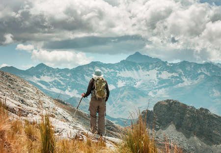 Man in a hike in the summer mountains. Beautiful natural landscapes.