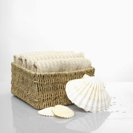 Towels in a cane basket Stock Photo