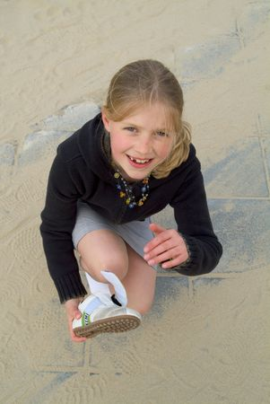 girl with sand in her shoes photo