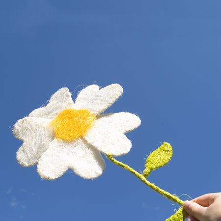 get together: i give you a paper flower (against deep blue sky) Stock Photo