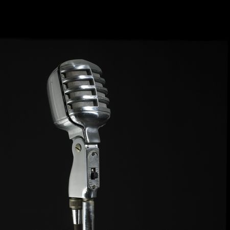 vintage microphone (black background and copy space) Stock Photo