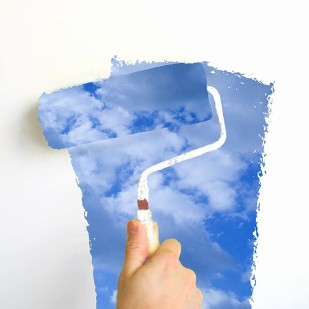 spring interior renovation : painting a wall with sky blue paint photo