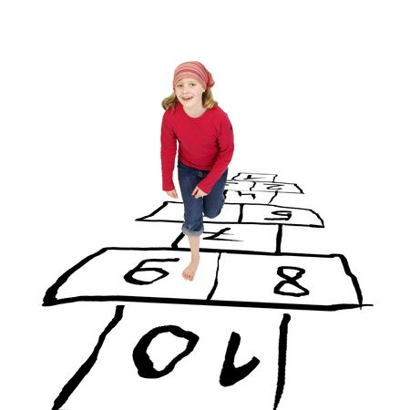 hopscotch: girl hopping around playing hopscotch