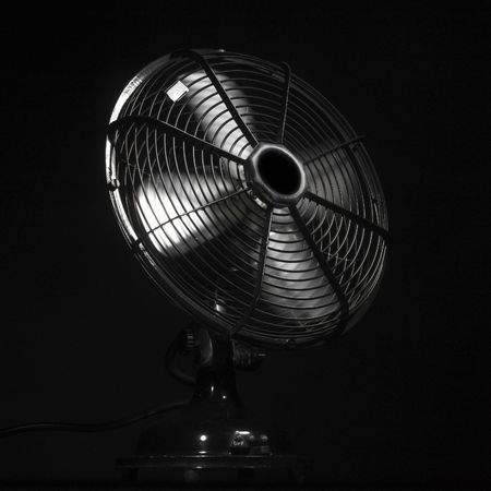 ventilator or fan in action (black background) photo