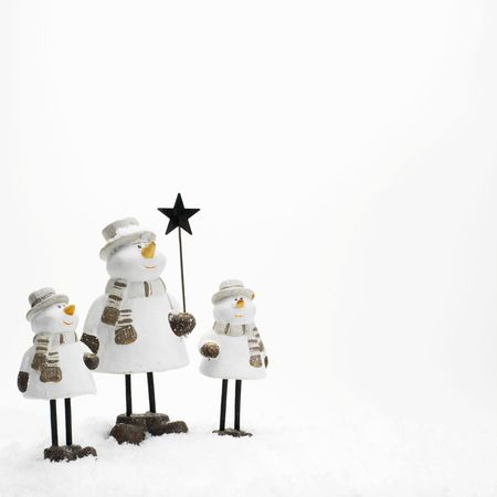 little snowmen standing in the snow (copy space) photo