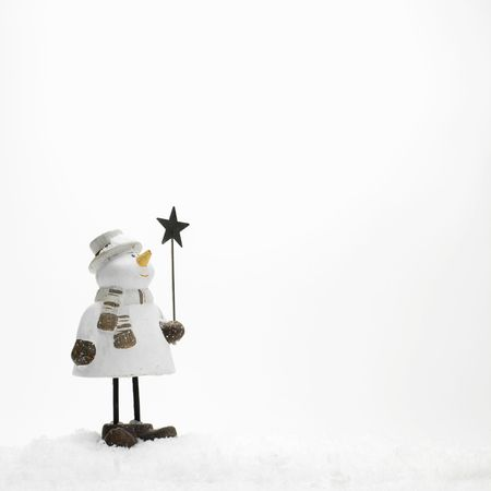 little snowmen standing in the snow (copy space)