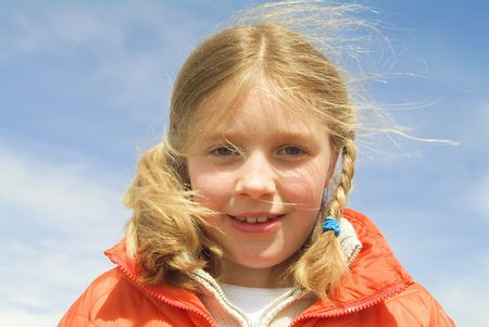 close-up of a young girl at the beach