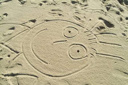 drawing in the sand : funny face photo