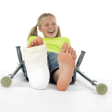 girl with a broken leg (close-up of feet, one with a plaster bandage) photo
