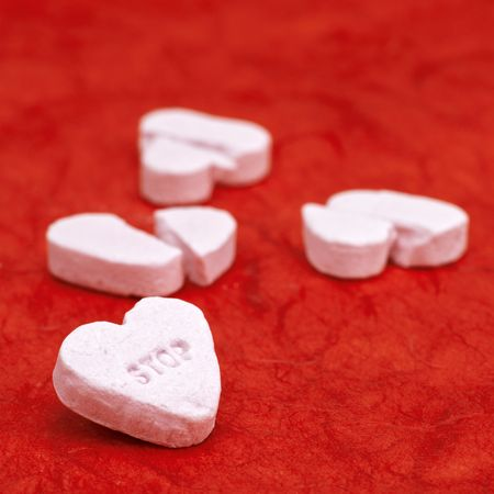 cheerless: stop ! broken hearts on a red background Stock Photo