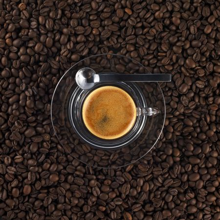 coffee grains: glass coffee cup with fresh made espresso (black background)