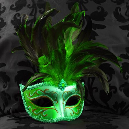 green jealous mask (Venice) on a black velvet background