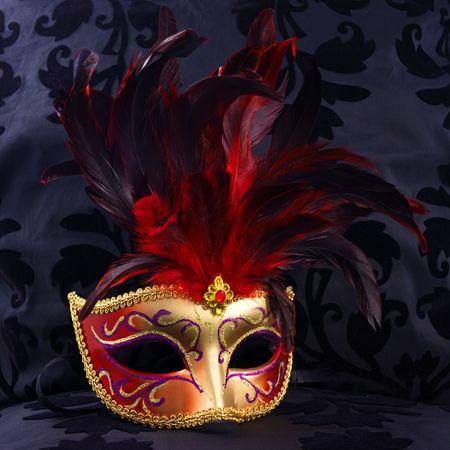 mystical woman: red and golden mask (Venice)  black velvet background Stock Photo