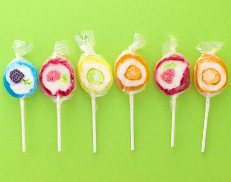 colorfull sweet lollipops on a green background Stock Photo