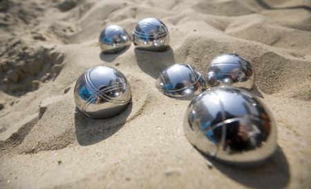 close-up of metal boccie balls in the sand Stock Photo