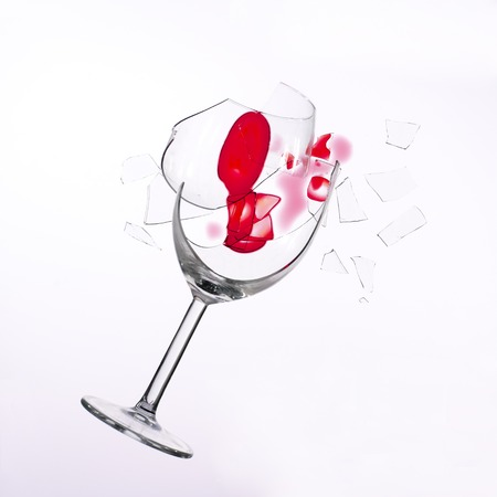 projectile: fallen wine glass with red wine in it