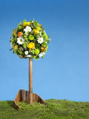 arrangment: easter tree flower arrangment, blue sky and copy space Stock Photo